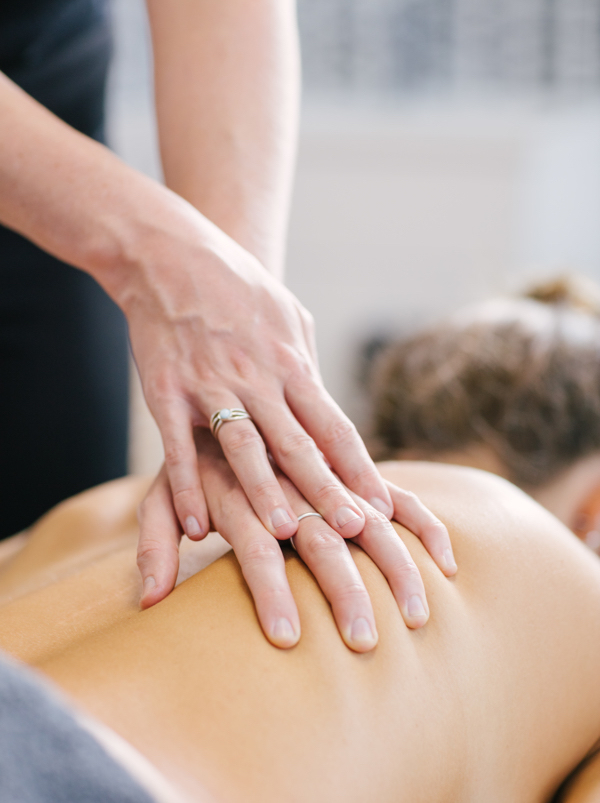 myotherapist performs manual therapy on muscles of the ribcage