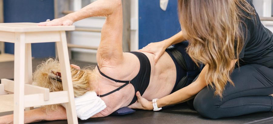 Physiotherapist working with a scoliosis patient in therapy gym