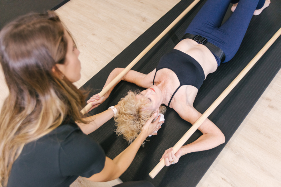 Adult with Scheuermann's Kyphosis doing exercises at The Scoliosis Collective