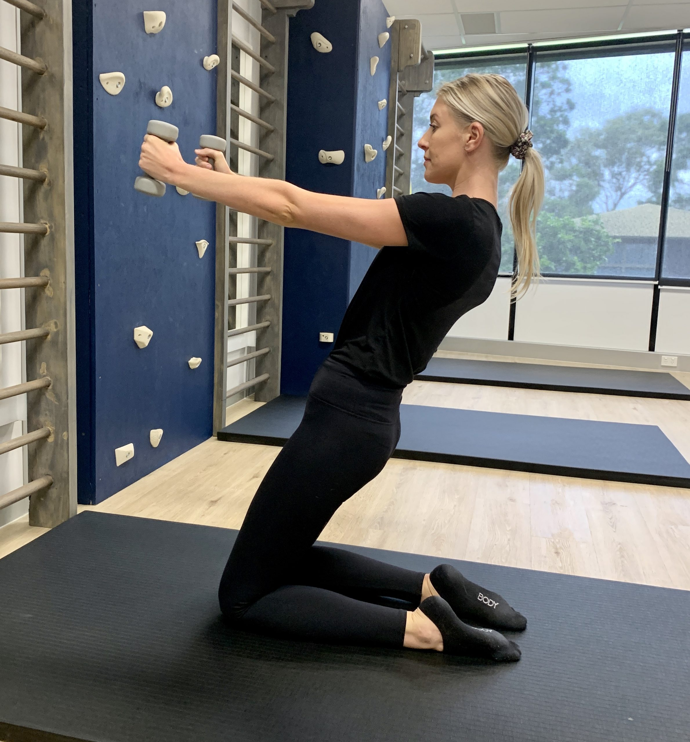 pilates instructor performing a core exercise